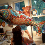Denise Sirchie working on a sculpture of a fish in her studio