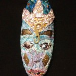 Oblong mask with blue face and gold crown