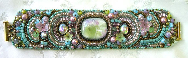Elaborately beaded bracelet in turquoise, pinks, green