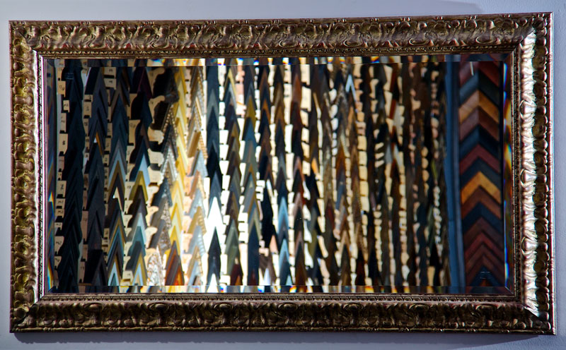 Picture of large mirror with elaborate gilt frame