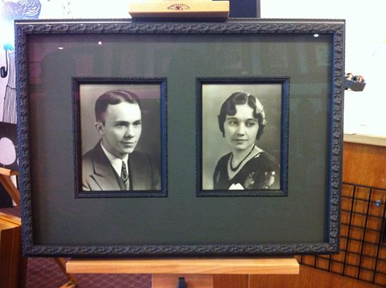 Professionally framed antique photos of man and woman