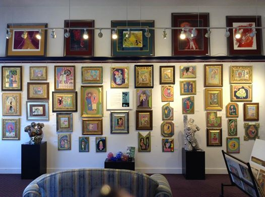 Photograph of gallery wall showing large number of Jerry Hammel's works