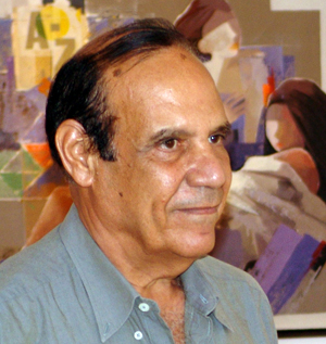 Artist Farooq Hassan in front of one of his paintings