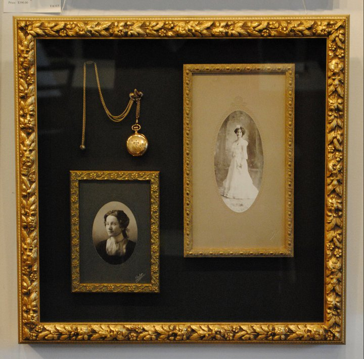 Shadow box with two antique photos of a woman and a pocket watch