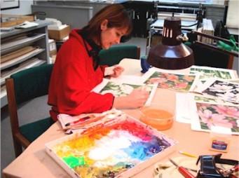 Artist Jennifer Bowman painting in her studio