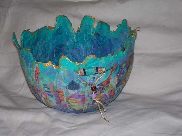 Blue, multi-media bowl with village scene around outside
