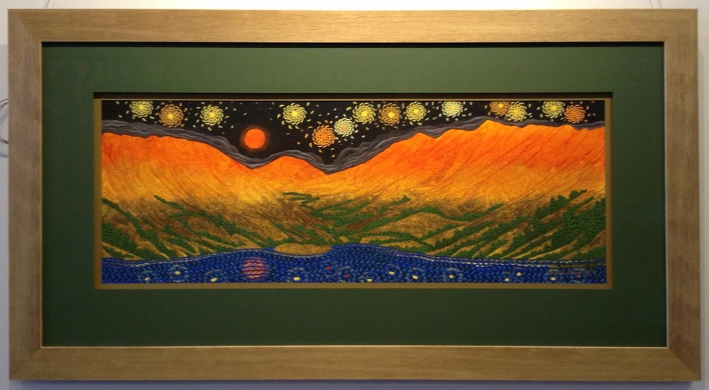Colorful print of mountains under a starry sky.