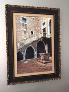 Framed photograph of a street in Venice