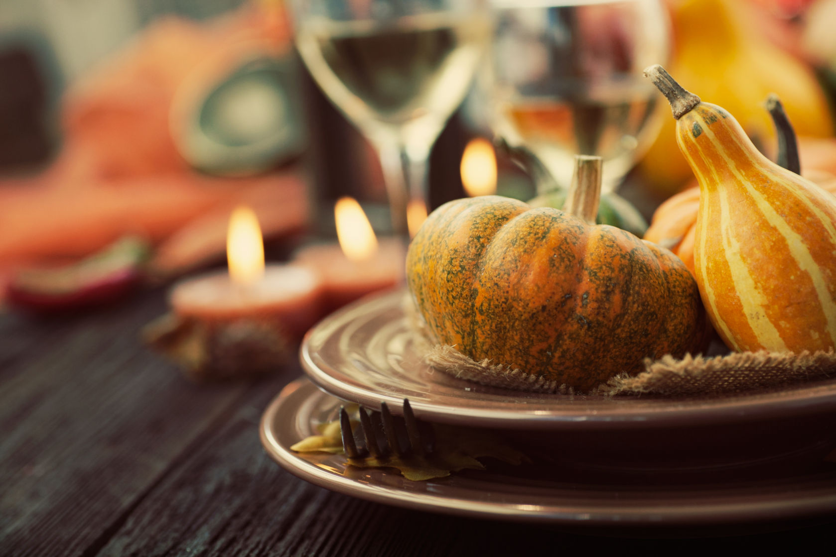 Autumn table setting with pumpkins.