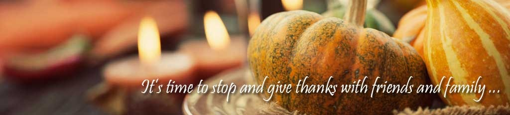 "Autumn table setting with pumpkins. Message overlaid is, ""It's time to stop and give thanks with friends and family."""