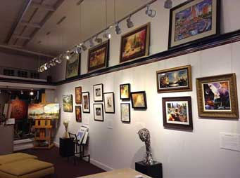 Paintings and sculpture exhibit inside Village Frame & Gallery