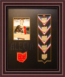Shadowbox with gymnastic medals and picture of young gymnast