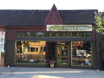 Front of Village Frame & Gallery, which has just been repainted and gotten a new sign