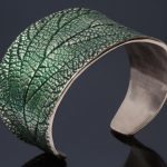 Cuff bracelet with hammered leaf motif