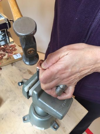 Close up of Amarinda Alpern's hands making jewelry
