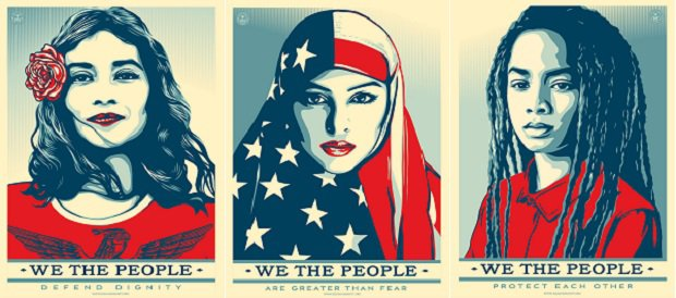 "Three red, white, and blue art posters, one depicting a Latina that says ""We the people defend dignity,"" one depicting a Muslim woman that says ""We the people are greater than fear,"" and one depicting an African American woman that says, ""We the people protect each other."""