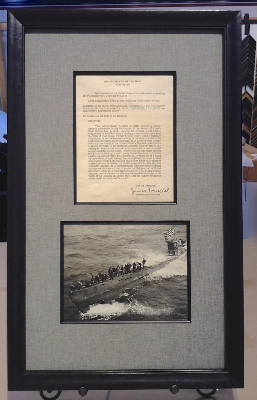 Presidential Unit Citation for the capture of U-505 during WWII and a photo of the US crew at sea framed together