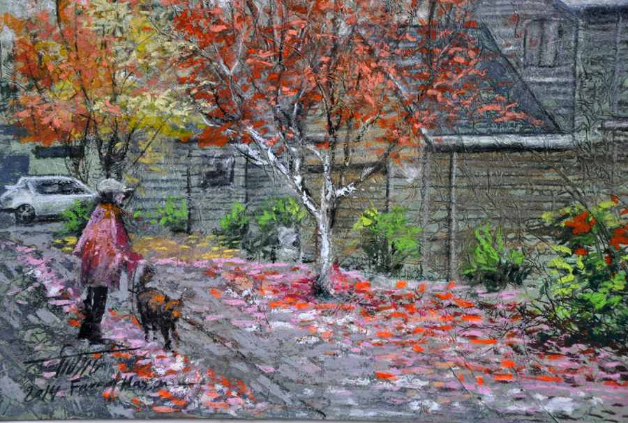 Landscape of autumn street. A woman and dog are walking past a building under trees with colorful leaves.