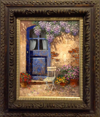Framed oil painting of small patio outside blue door. A chair and pots of colorful flowers are arranged on the patio.