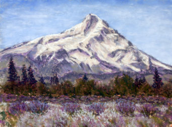 Mountain rising above a field of lavender
