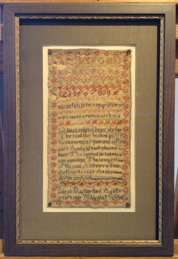 Framed antique embroidered sampler